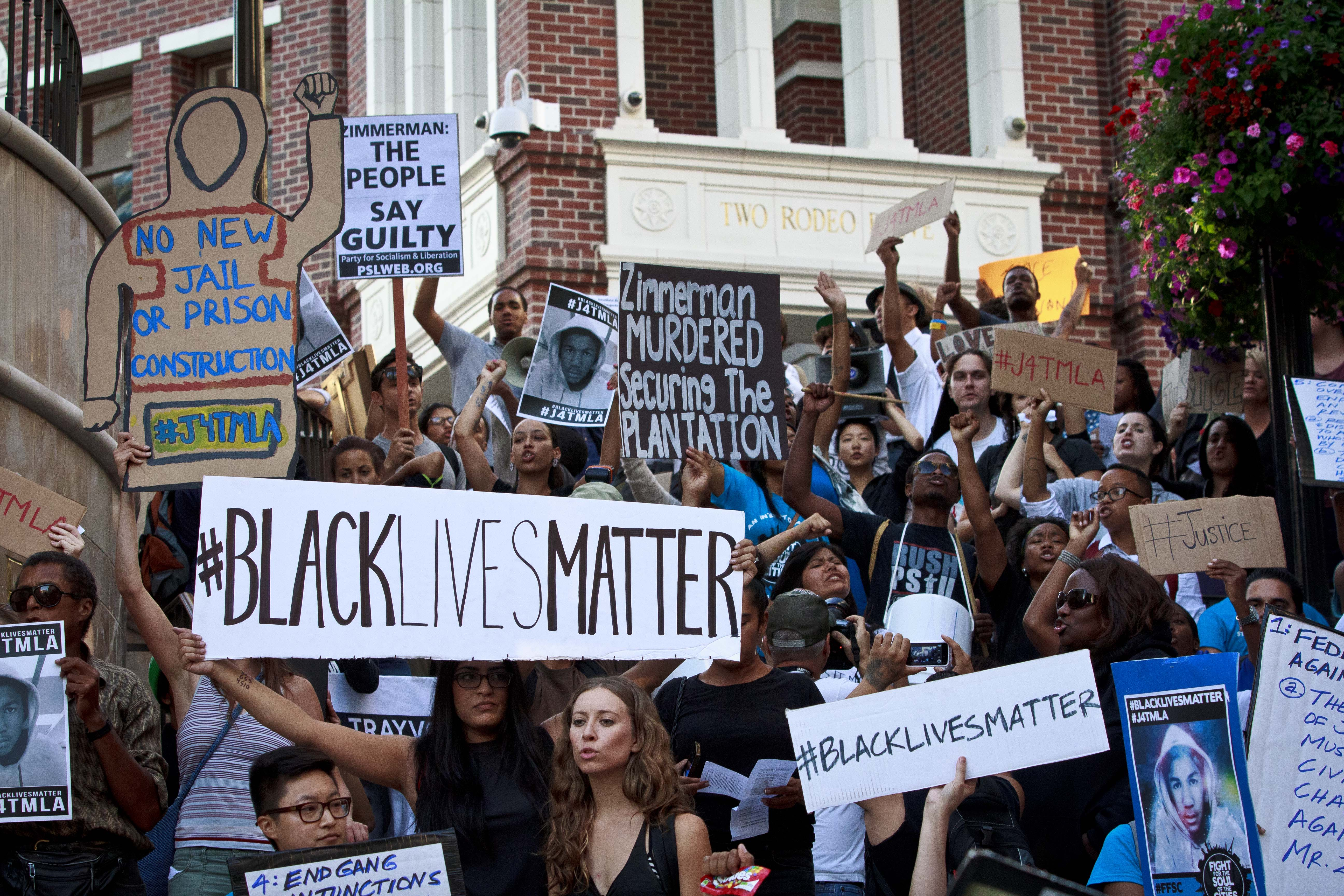 Protesters take to the streets to bring attention to the push for justice in the Trayvon Martin case as they take over Rodeo Drive on July 17, 2013 in Beverly Hills, California. (Photo by Jose Lopez)